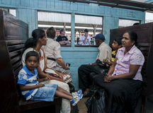 Tourists and local Sri Lankans wait for a train to leave the Kandy train station. stock images