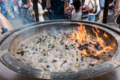 Tourists and Local are worshiping the shrine. Tokyo, Japan - May 1, 2017: Tourists and Local are worshiping the shrine through the incense in Sensoji Shrine Royalty Free Stock Images