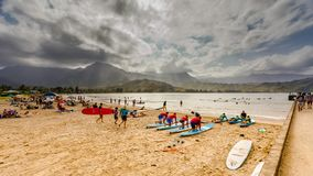 Tourists and locals alike enjoy the warm afternoon in Hanalei Bay`s Waioli Beach