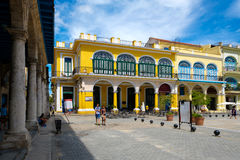 Tourists and locals at a colorful square on Old Havana Stock Photography