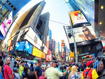 Tourists and locals crowd at famous Times Square in New York. NEW YORK,USA - AUGUST 14,2015 : Tourists and locals crowd at famous Times Square in New York City stock image