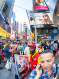 Tourists and locals crowd at famous Times Square in New York. NEW YORK, USA - AUGUST 14, 2015 : Tourists and locals crowd at famous Times Square in New York City royalty free stock images