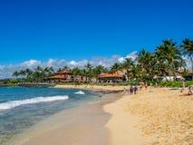 Tourists and locals enjoy Poipu Beach, Kauai. KAUAI, USA - MAR 3: Tourists and locals enjoy Poipu Beach on March 3, 2017 on Kauai, Hawaii. Poipu Beach is one of royalty free stock images