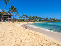 Tourists and locals enjoy Poipu Beach Stock Images
