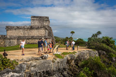 Tourists and locals enjoying a sunny day at the Tulum ruins Royalty Free Stock Photo