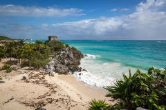 Tourists and locals enjoying a sunny day at the Tulum ruins Stock Image
