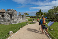 Tourists and locals enjoying a sunny day at the Tulum ruins Stock Photography