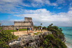 Tourists and locals enjoying a sunny day at the Tulum ruins Royalty Free Stock Image