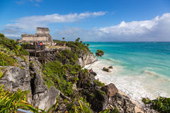 Tourists and locals enjoying a sunny day at the Tulum ruins Stock Photos