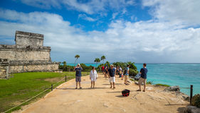 Tourists and locals enjoying a sunny day at the Tulum ruins Stock Images