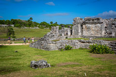 Tourists and locals enjoying a sunny day at the Tulum ruins in Tulum City, Mexico Stock Photo