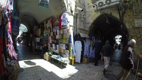 Tourists and locals at Jerusalem's old city market stock video