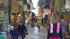 Tourists and locals at Jerusalem's old city market stock video footage