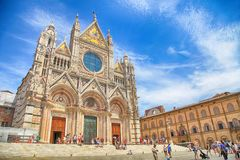 Tourists and locals next to The Cathedral of Siena, Italy. stock photos