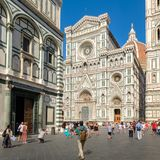 Tourists and locals at Piazza del Duomo with a view of the Cathedral of Florence Royalty Free Stock Images
