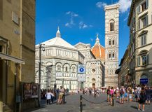 Tourists and locals at Piazza del Duomo with a view of the Cathedral of Florence Royalty Free Stock Photos
