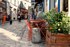 Tourists and locals on a quiet pedestrian area in Monmartre Stock Images