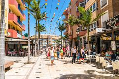 Tourists and locals shopping at the av. Blas Infante. Benalmadena, Spain, june 30, 2017: Tourists and locals shopping at the av. Blas Infante stock image