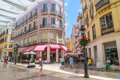 Tourists and locals shopping at the Calle Marquis de Larios. Malaga, Spain, june 27 2017: Tourists and locals shopping at the Calle Marquis de Larios royalty free stock image