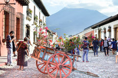 Tourists and locals stroll the cobble stone streets of the beautiful colonial city of Antigua on a sunny day, in Guatemala Stock Image