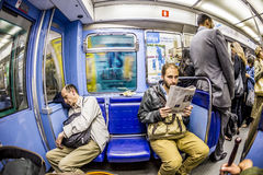 Tourists and locals on a subway train line 8 in Paris Royalty Free Stock Photography