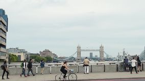 Tourists an locals taking photos Tower Bridge. LONDON, UNITED KINGDOM - CIRCA 2016: People visiting London and taking tourist photos with Tower Bridge in the stock video footage