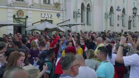 Tourists and locals walk in Nikolskaya street and make photos of Tunisian fans. Tourists and locals walk in Nikolskaya street in Moscow and make photos of stock video