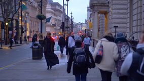 Tourists in London at Christmas time - LONDON, ENGLAND - DECEMBER 10, 2019