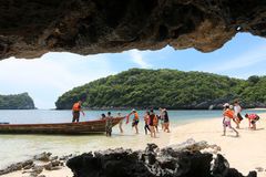 Tourists with long-tail boats trip around the archipelago island Stock Image