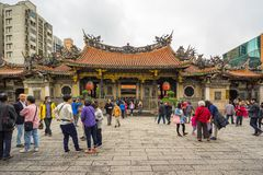 The tourists at Longshan Temple in Taipei, Taiwan Stock Photo