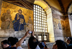 Tourists look at ancient mosaics in Hagia Sophia, istanbul Stock Images