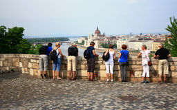 Tourists look at the Hungarian Parliament from the Buda side. BUDAPEST, HUNGARY - MAY 14: A view of the Hungarian Parliament from the Buda side in the May 14 Stock Photography