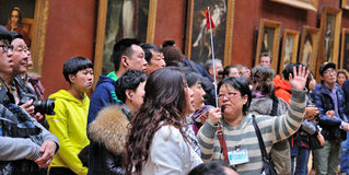 Tourists look at the paintings at the Louvre Museum (Musee du Louvre) Royalty Free Stock Image