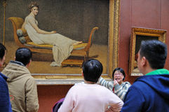 Tourists look at the paintings at the Louvre Museum (Musee du Louvre) Royalty Free Stock Photos