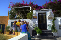 Tourists look at restaurant menu, Santorini Greece Royalty Free Stock Images