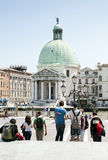 Tourists look on Santa Maria della Salute Basilica Stock Photo