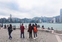 Tourists look at Victoria Harbour, Hong Kong Royalty Free Stock Image