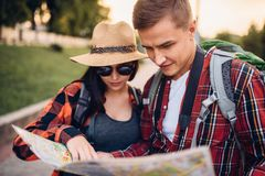 Tourists looking for city attractions on the map royalty free stock image