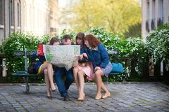 Tourists looking for direction in Paris Stock Photography