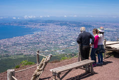 Tourists looking down to the sea from Mount Vesuvius. Royalty Free Stock Images