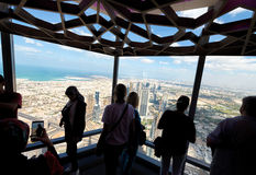 Tourists looking at Dubai cityscape from a high vantage point, U Stock Image