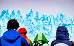 Tourists looking at gigantic icebergs from a ship. In Greenland royalty free stock image