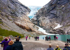 Tourists looking at glacier Royalty Free Stock Photo