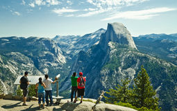 Tourists looking at Halfdome in Yosemite National Park Royalty Free Stock Photography