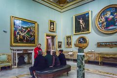 Tourists looking interiors, painting and sculptures in Borghese. Rome, Italy – March 21, 2018: Tourists looking interiors, painting and sculptures in royalty free stock photos