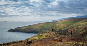 Tourists looking at the landscape of Madeira east coast. Royalty Free Stock Photography