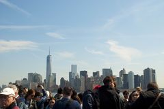 Tourists looking at Manhattan from a ferry Royalty Free Stock Images