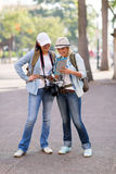 Tourists looking map Stock Images