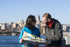 Tourists looking at the map in Istanbul amidst the sights Royalty Free Stock Photo