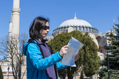 Tourists looking at the map in Istanbul amidst the sights Stock Photography